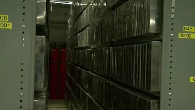general views of archive; england: london: gray's inn road: int 'itn source' logo on wall / film cans in archive vaults storage area and rolling... - inch stock videos & royalty-free footage