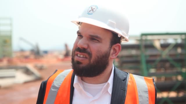 """Source ref ID Guys in suits at construction site 00003917 00004101 1 430WQX8_J846ZGGJ5 [originally from """"Gertler Earns Billions in Congo CutPrice..."""