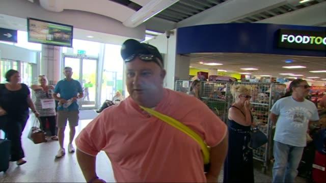 britons confirmed dead; england: bristol: passengers arriving in airport terminal mark beard interview sot - イングランド南西部点の映像素材/bロール