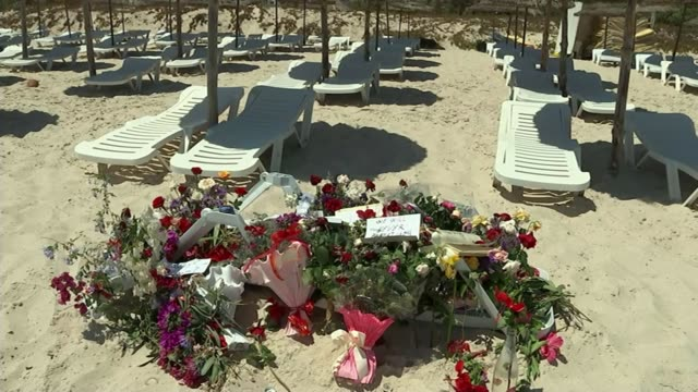 Amateur video footage of final moments emerges 2882015 Tourists riding quad bikes along beach Message 'We Will Never Forget You' on floral tribute...