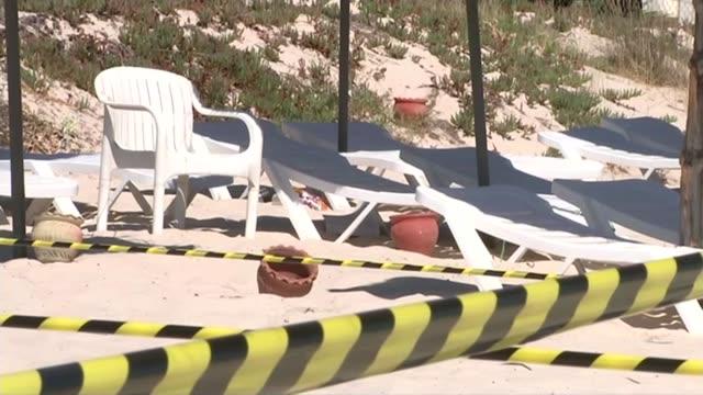 british victims accounts; various shots sunbeds, beach chairs and beach umbrellas at scene of attack with police cordon tape around area geranium... - ゼラニウム点の映像素材/bロール