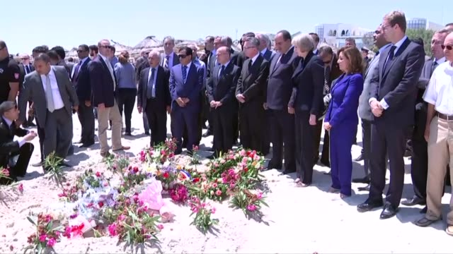 theresa may lays flowers for the victims; 29.6.2015 theresa may mp , najem gharsalli , thomas de maiziere , bernard cazeneuve and others visiting... - bernard cazeneuve stock videos & royalty-free footage