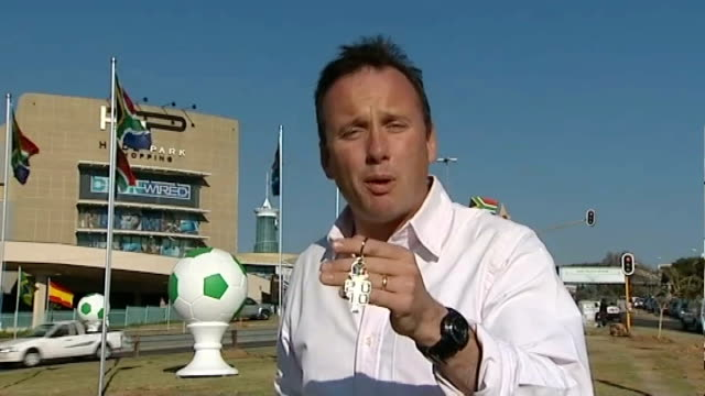 south africa 2010 world cup: allegations that local people sidelined by event organisers; reporter to camera and fifa keyring held up - fifa bildbanksvideor och videomaterial från bakom kulisserna