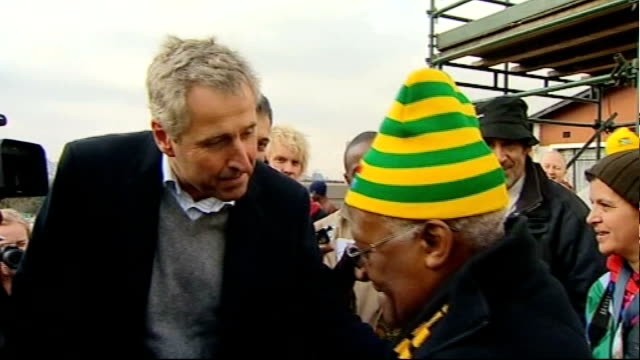 archbishop desmond tutu interview south africa soweto ext archbishop desmond tutu greeting itn reporter mark austin in street group of south africa... - soweto stock videos and b-roll footage