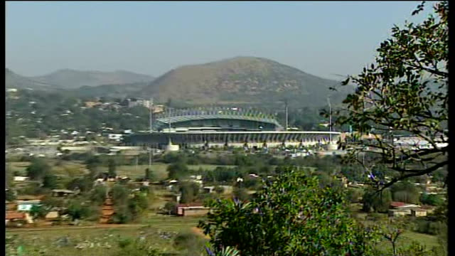 england squad arrive at training camp rustenburg phokeng wide shot of royal bafokeng stadium as cockerel crowing heard sot reporter to camera with... - crowing stock videos & royalty-free footage