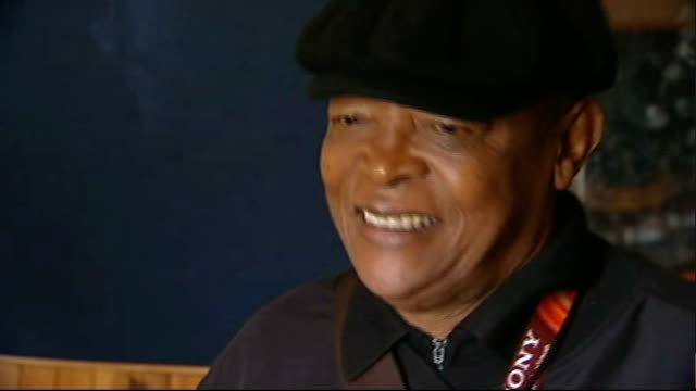 south africa 2010 world cup: future impact of tournament on the nation; south africa: johannesburg: int close up of hugh masekela performing song sot... - international team soccer stock videos & royalty-free footage