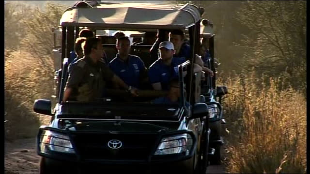 south africa 2010 world cup: local referee interviewed following wayne rooney incident; south africa: rustenburg: ext jeeps carrying england team on... - fußballweltmeisterschaft 2010 stock-videos und b-roll-filmmaterial
