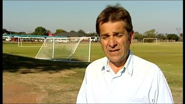 south africa 2010 world cup: local referee interviewed following wayne rooney incident; reporter to camera - fußballweltmeisterschaft 2010 stock-videos und b-roll-filmmaterial