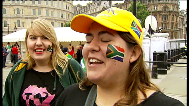 london big screen vox pops sot reporter to camera sot old man dancing with south african woman people gathered to watch world cup football on big... - fußballweltmeisterschaft 2010 stock-videos und b-roll-filmmaterial