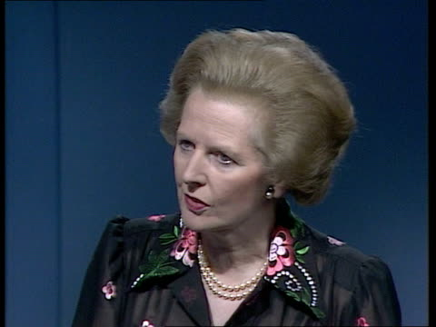 margaret thatcher under pressure to impose sanctions e england london itn int margaret thatcher mp studio interview sot on sanctions for south africa - south africa stock videos & royalty-free footage