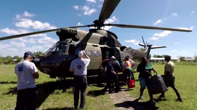 south african aid flies into the storm stricken area of beira in mozambique as more international aid groups are able to reach communities previously... - mozambique stock videos & royalty-free footage
