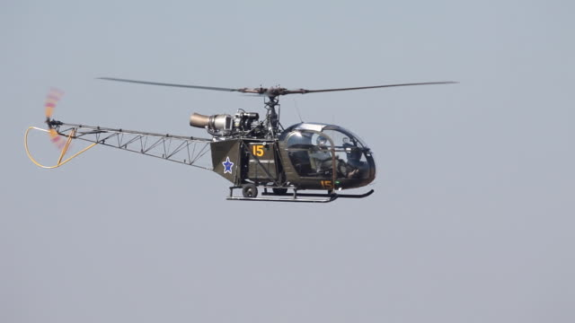 ws south african airforce alouette ii helicopter hovering in sky / johannesburg, gauteng, south africa - hubschrauber stock-videos und b-roll-filmmaterial