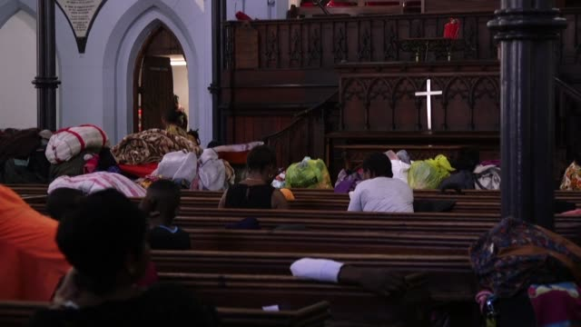 a south african anglican archbishop was among the injured friday when violent scuffles broke out at a cape town church where hundreds of foreign... - anglican stock videos and b-roll footage
