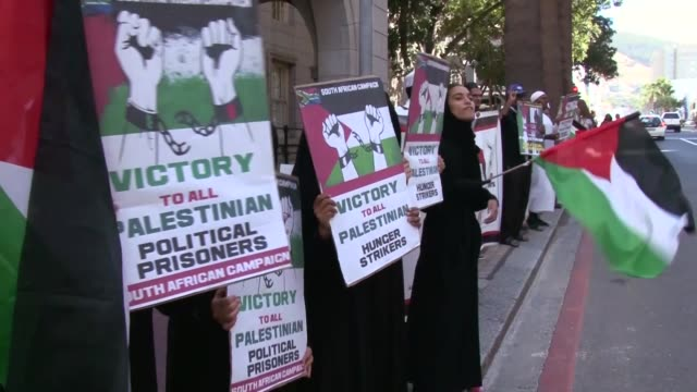 south african demonstrators stage a protest in solidarity with israeliheld palestinian prisoners who are on hunger strike to protest their prison... - prisoner icon stock videos & royalty-free footage