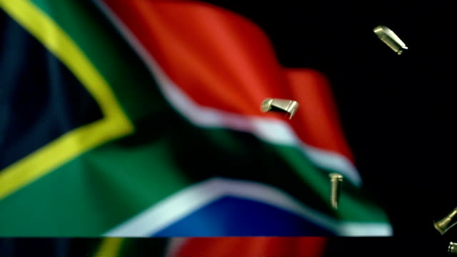south african flag behind bullets falling in slow motion - weaponry stock videos & royalty-free footage