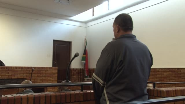 stockvideo's en b-roll-footage met a south african man accused of abusing his five children while allegedly keeping them captive for more than a decade appeared briefly in a court east... - gauteng provincie