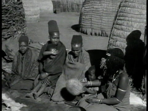 South African native farmers huts hills BG MS Indigenous African women sitting w/ children VS Topless women in tribal wear performing native dance VS...