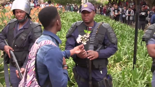 south african police fire rubber bullets stun grenades and teargas at student protesters in johannesburg as authorities try to re open the... - authority stock videos & royalty-free footage