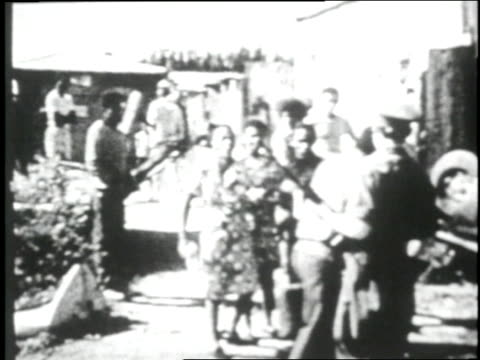 vidéos et rushes de south african police officers carry wounded protesters into ambulances while arresting other rioters during outbreaks in the oppressed area of... - 1970