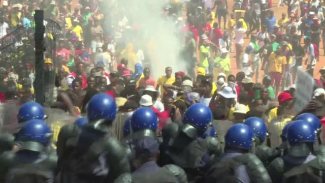 South African President Jacob Zuma abandons proposed hikes to university fees after days of protests culminating in police firing stun grenades at...