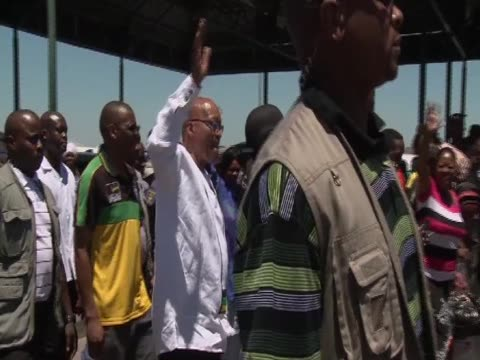 South African President Jacob Zuma greets crowds during the celebration of the 100th anniversary of the African National Congress
