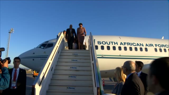 south african president jacob zuma is welcomed by eu minister beril dedeoglu upon his arrival at the antalya international airport for the upcoming... - g20 leaders' summit stock videos & royalty-free footage