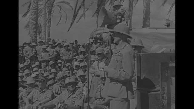 south african soldiers gathered in desert / south african prime minister jan smuts speaking to soldiers / two shots of soldiers listening / mrs issie... - dart board stock videos & royalty-free footage