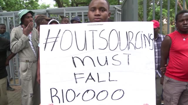 south african university employees demonstrate to demand higher salaries and insourcing of their work as opposed to the universities current... - outsourcing stock videos & royalty-free footage