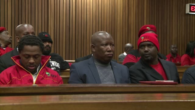 south africas populist opposition leader julius malema arrived at court in pretoria on monday facaing charges of tax fraud - populism stock videos and b-roll footage