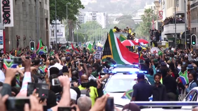 south africa's rugby stars on monday hoisted the world cup before thousands of ecstatic fans at cape town's city hall where nelson mandela made his... - cape town stock videos & royalty-free footage