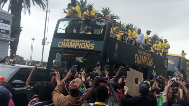 south africa's rugby world cup final winning team enjoy an open top bus parade through the streets of cape town the springboks brushed aside a... - parade stock videos & royalty-free footage