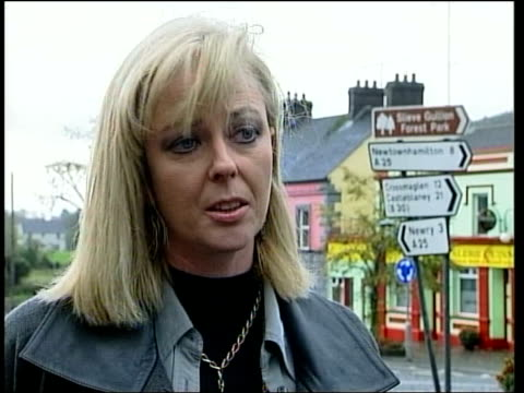 south armagh: sign 'ruc the armed wing of unionism' with irish flag flying sign 'demilitarise - brits out' with irish flag flying irish flag pull... - ceasefire stock videos & royalty-free footage