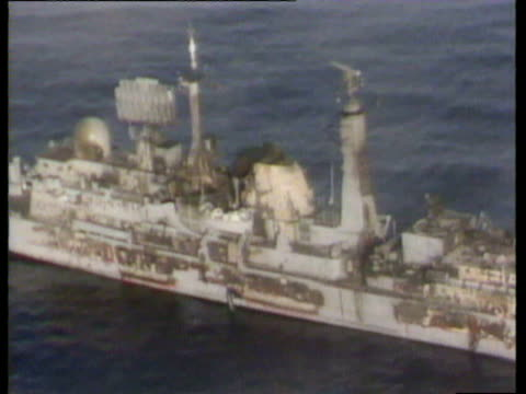 south atlantic / aerial views of first pictures of hms sheffield after it had been hit by an exocet missile / smoke billowing from ship / wreckage of... - 1982 stock videos & royalty-free footage