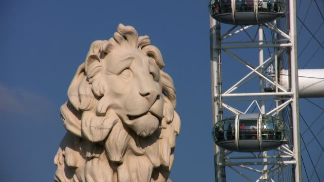 south bank lion statue and the london eye. - lambeth stock videos & royalty-free footage
