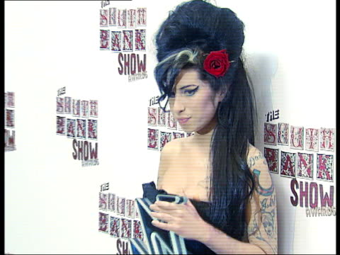 backstage interviews and photocalls Amy Winehouse posing for photocall and speaking to press
