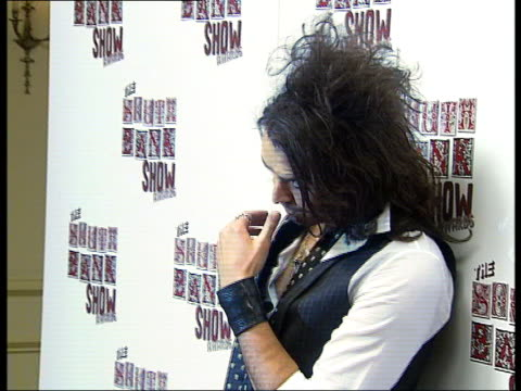 backstage interviews and photocalls Russell Brand posing for photocall