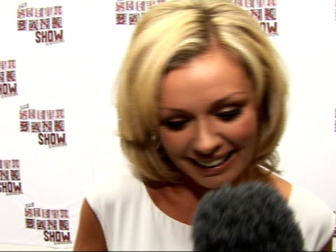 south bank show awards: photocall and interviews; katherine jenkins interview sot - on performing at the south bank awards / to be honest i've been... - day lily stock videos & royalty-free footage