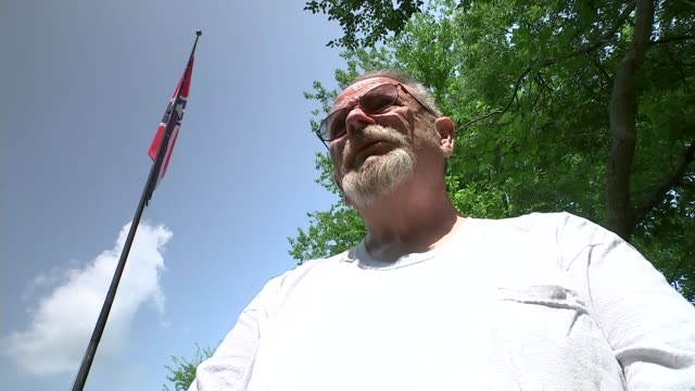 confederate flag to be taken down from outside state capitol virginia stafford various of confederate flag flying close to major highway reporter... - confederate flag stock videos and b-roll footage