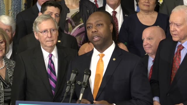 South Carolina Senator Tim Scott opens an enrollment ceremony on the Tax Cuts and Jobs Act to say that Christmas is coming early as the House and...