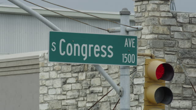cu of south congress ave street sign in austin - western script stock videos & royalty-free footage