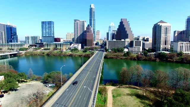 south congress avenue bridge with austin texas skyline background with texas state capital in the distance - government building stock videos and b-roll footage