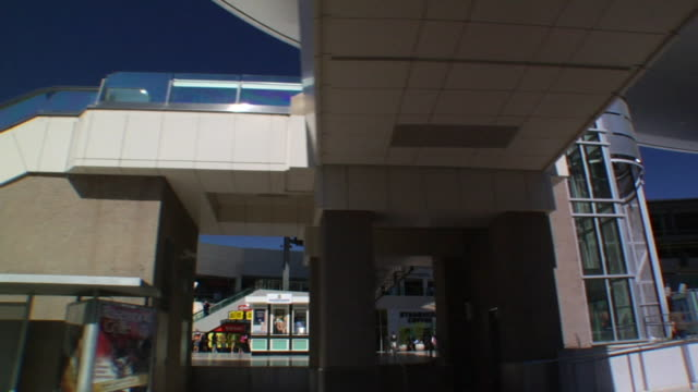 south down las vegas boulevard under overpass passing neiman marcus store in fashion show mall w/ highrise construction bg the strip - neiman marcus stock videos & royalty-free footage