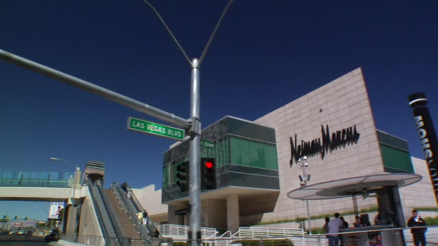 south down las vegas boulevard under overpass passing neiman marcus store in fashion show mall stairs pedestrian walkway the strip - neiman marcus stock videos & royalty-free footage