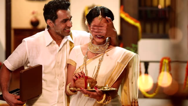 South indian couple celebrating diwali festival, Delhi, India