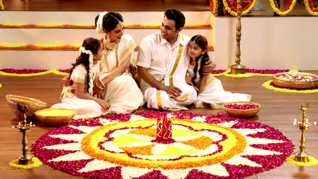 south indian family celebrating onam festival, delhi, india - religious celebration stock videos & royalty-free footage