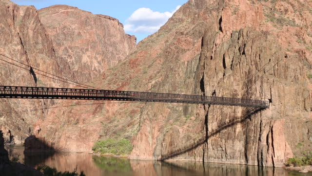 South Kaibab Trail Bridge hangs over the Colorado River in Grand Canyon National Park, Arizona.