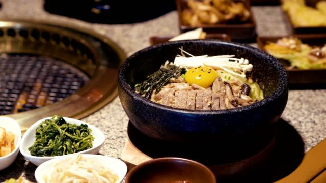 south korea : bi bim bap - mixing stock videos and b-roll footage