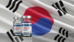 South Korea Flag and Vaccine Covid-19 Corona Virus Concept bottle vial. Depth of field.