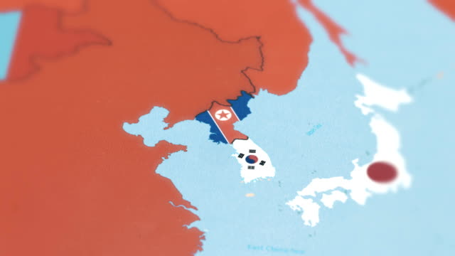 South Korea, North Korea with National Flag on World Map