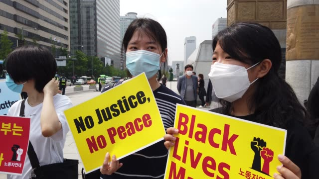 south korean activists gather to mourn the death of george floyd and show solidarity with the black lives matter movement near the u.s. embassy on... - east asian ethnicity stock videos & royalty-free footage